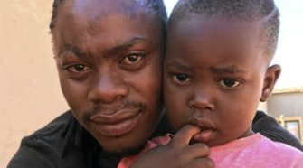 Sipho Skosana with his slain son Bandile Skosana. Bandile was found crushed under a boulder in Rethabiseng, Bronkhorstspruit PIC: SUPPLIED